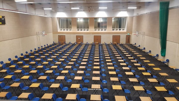 exam tables and chairs in exam hall
